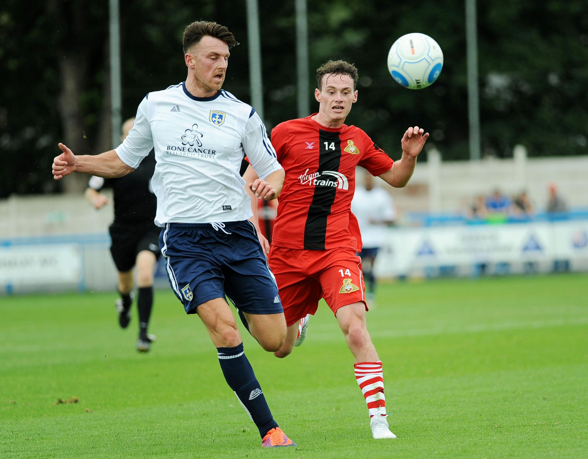 Jake Lawlor, left, headed Guiseley's best chance wide after it came back to him off a post