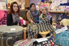 From left, Tamana Arifi, Saira Bibi and Halima Khan have passed a creative crafting course, which includes upcycling junk