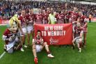 Wigan Warriors beat Salford Red Devils 27-14 to reach the Challenge Cup final