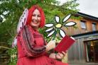 Fairy Caroline Lewis gets ready to make magic at an enchanted woods event in Cottingley