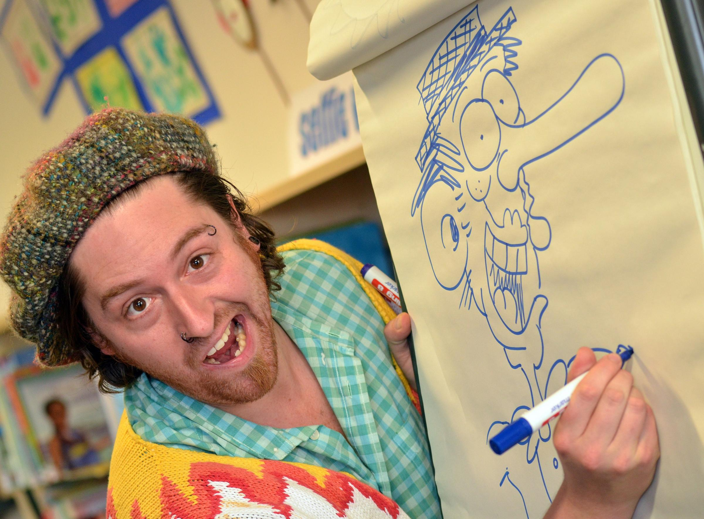 Cartoon artist Doctor Simpo at a comic book arts workshop at Bradford City Library..