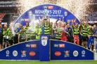 Huddersfield beat Reading after a penalty shoot-out at Wembley to win promotion to the Premier League for the first time in their history