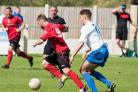 Silsden's Mateusz Tomas breaks clear in his side's opening day win over Sandbach