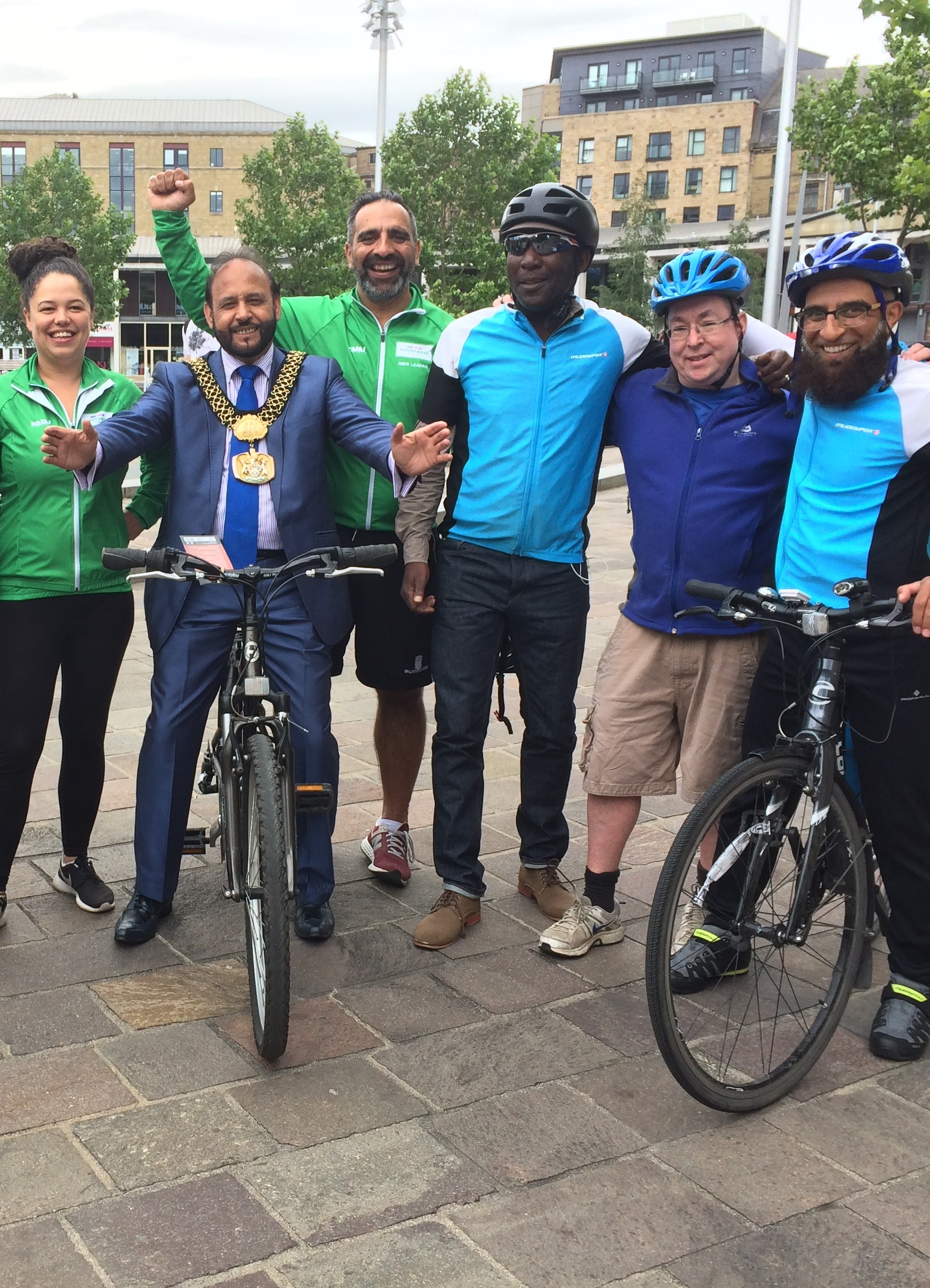 Rifaqat Ali (right) with cyclists taking part in a charity ride in July to benefit victims of the Manchester Arena bombing