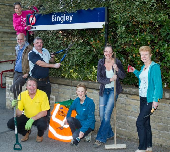 Volunteers of the Friends of Bingley and Crossflatts Railways Stations group spruce up one of the sites