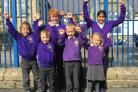 Former pupils of Aire View and Hothfield schools show off the purple uniform of their newly-merged Silsden Primary School