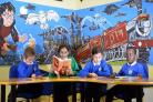 Pupils from St Oswald's CE Primary Academy have reopened the library. Tulisa Murphy, Anika Ahmed, Aniya Hussaina and Abdweli Mohamed reading in the transformed library.