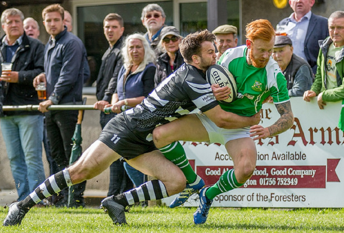 Otley winger Alex Beaumont pulls off a superb cover tackle on Wharfedale winger Ben Parkinson Picture: Ro Burridge