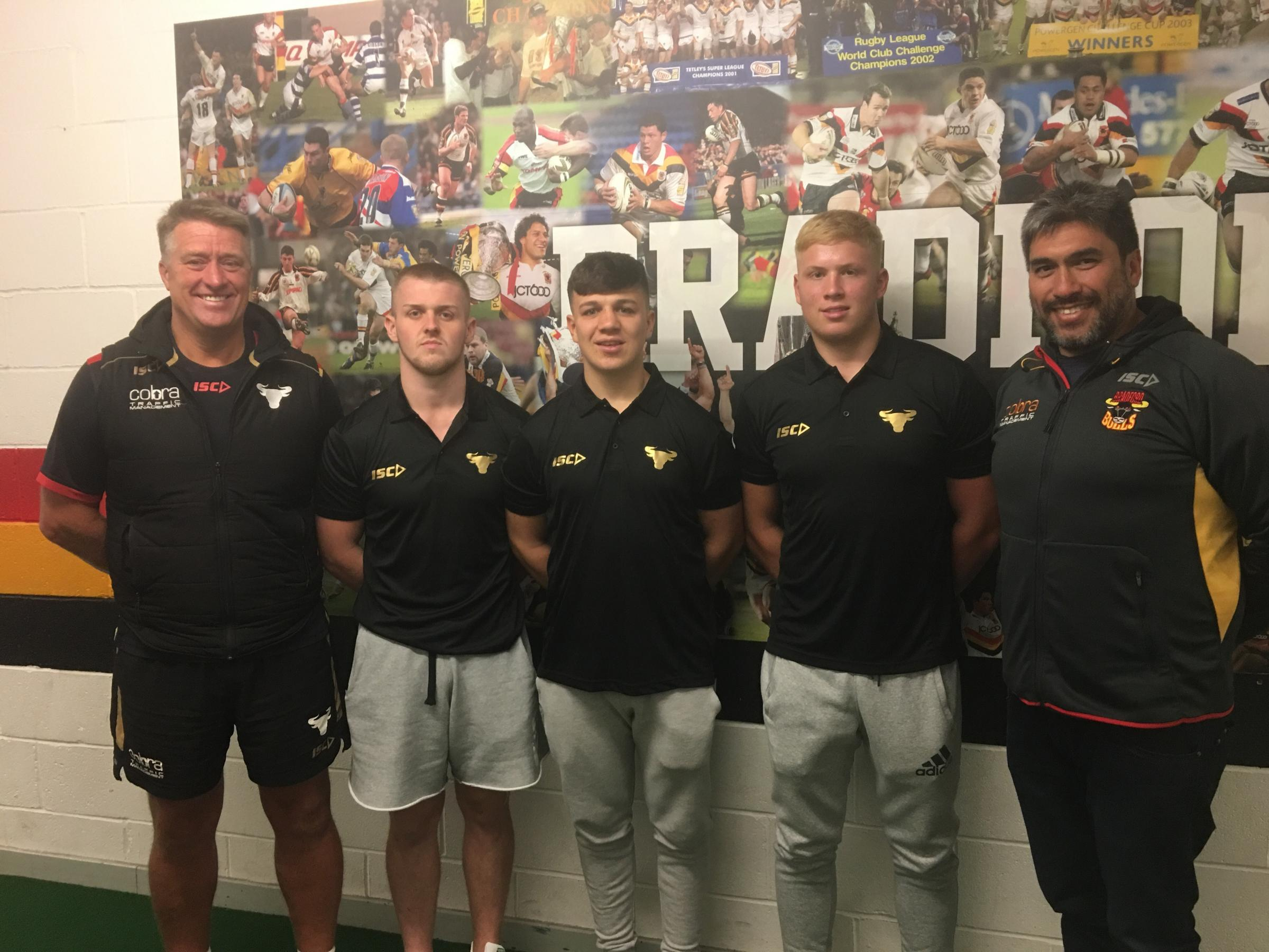 SIGNED UP: Evan Hodgson, Reiss Butterworth and Oliver Wilson with head of youth John Bastian, left, and Bulls co-owner Andrew Chalmers