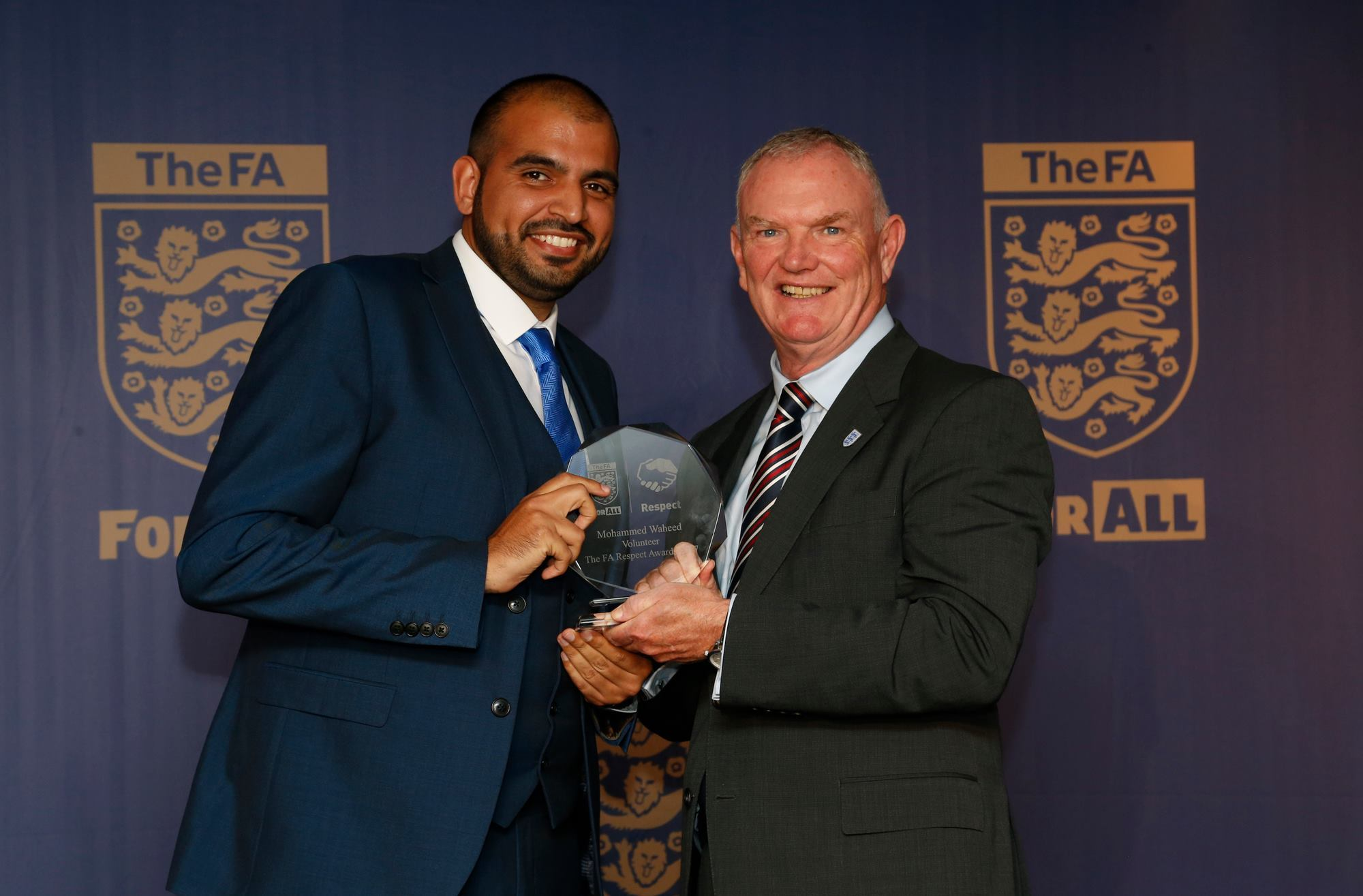 Mohameed Waheed receiving his award from FA chairman Greg Clarke