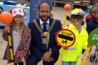 Mae Wilkinson, five, and Tia-Rose Curry, six, help the Lord Mayor of Bradford, Cllr Abid Hussain, brush-up on road safety at Braithwaite and Guard House Gala