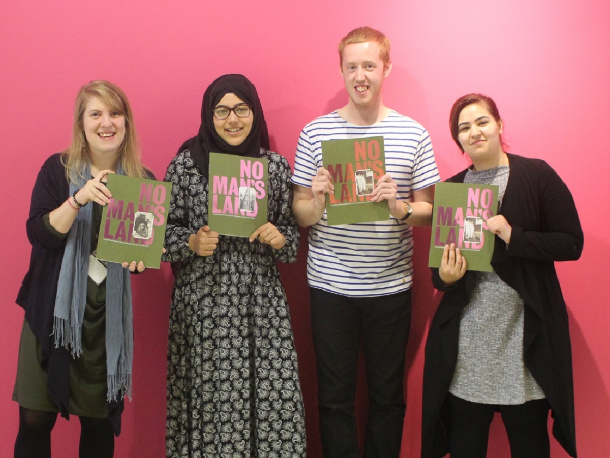 Members of the New Focus group with their book