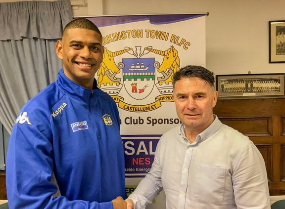 Leon Pryce is greeted by Workington chairman Garry Mounsey