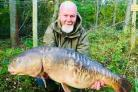 Richard Wood with the carp known as 'Wonky', which he caught for a second time this year from Kirklees Lagoon