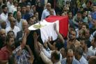 People carry the coffin of police captain Ahmed Fayez during his funeral at Al-Hosary mosque, in Cairo