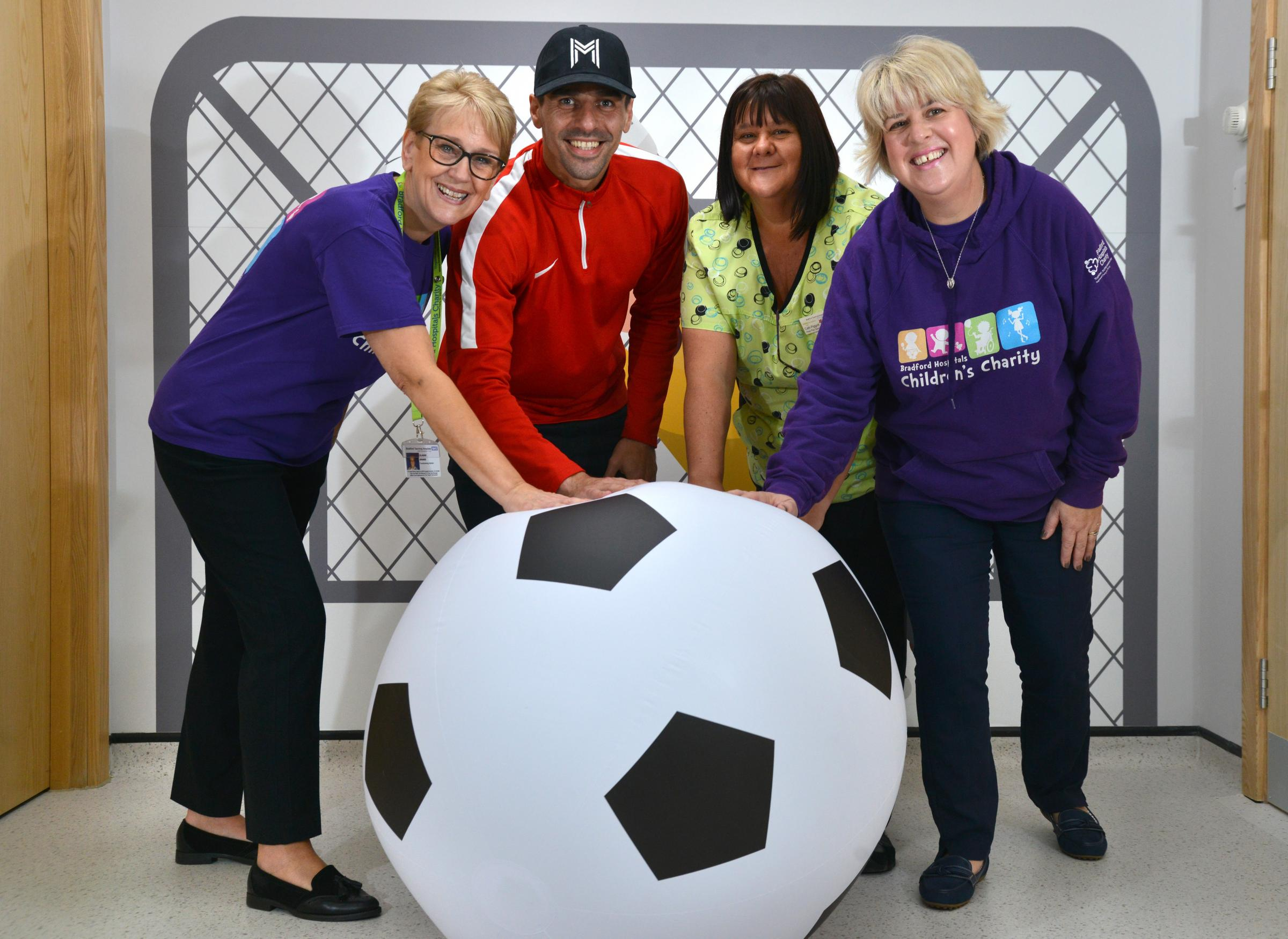 Former Bradford City winger Filipe Morais is returning to the city to give a £500 donation to the children's ward at BRI pictured with Elaine Drake, Filipe Morais, Cath Piggott and Hayley Collis