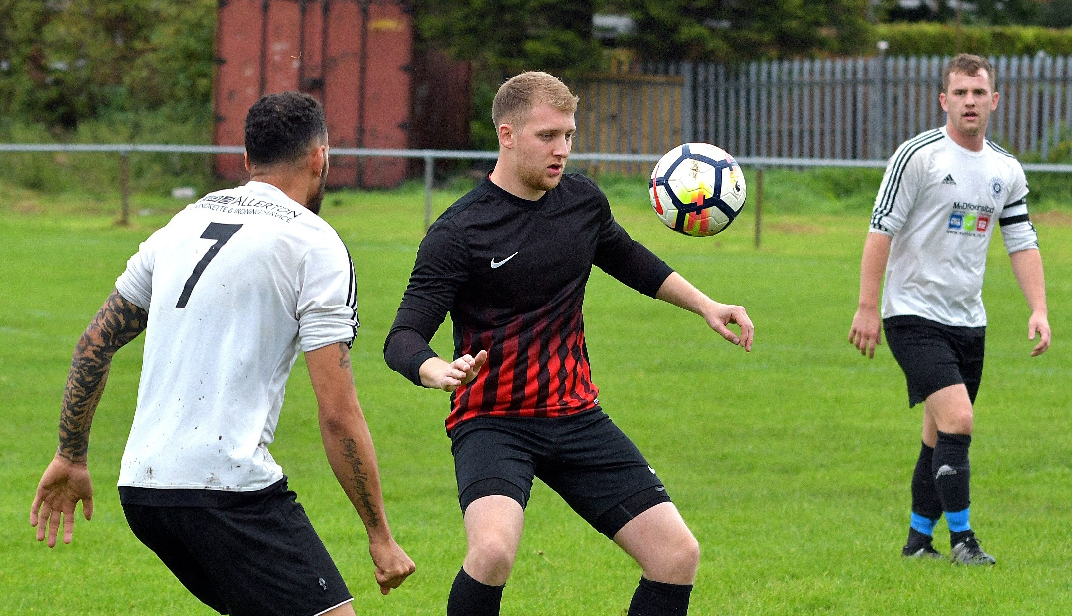 Sam Bradley of Olympic takes on Liam Charles of Thornton United in his side's recent 4-2 win