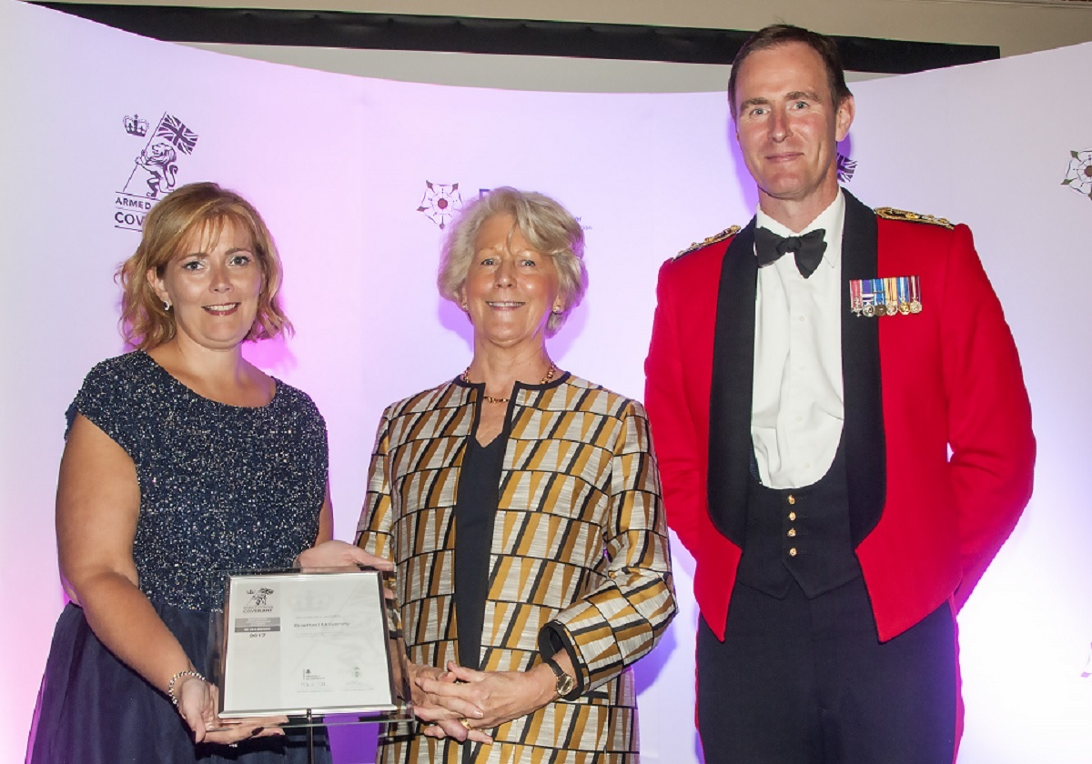 Joanne Marshall gets the award from Her Majesty's Lord-Lieutenant of West Yorkshire Dame Ingrid Roscoe DCVO, and Brigadier Oliver Stokes, Brigade Commander, 4th Infantry Brigade