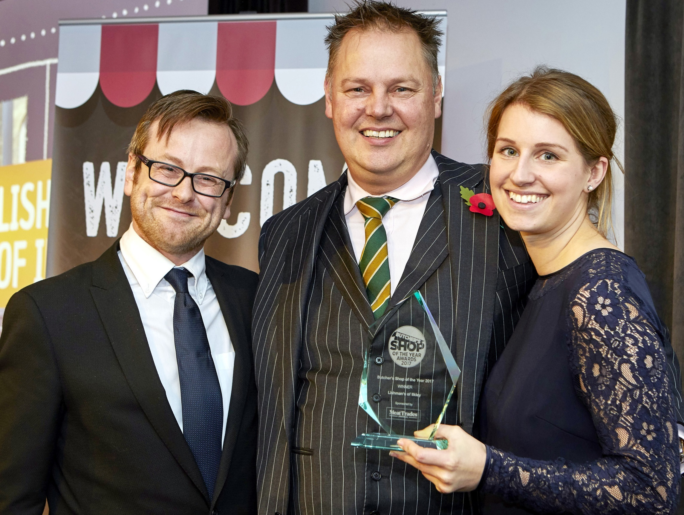 Father and daughter David and Emma Lishman are pictured after winning UK Butchers Shop of the Year, joined by Meat Trade Journal's deputy editor Aidan Fortune, left