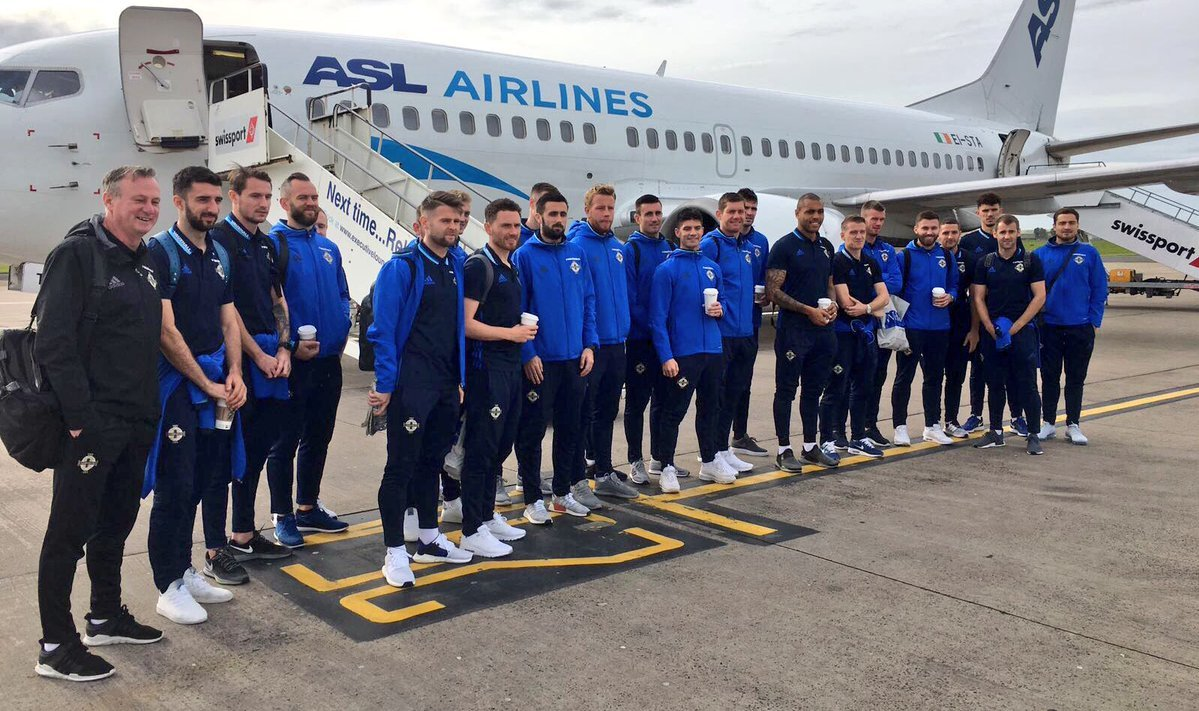 FLYING IRISH: Adam Thompson, centre, with the Northern Ireland squad before they flew out for the final group game in Norway