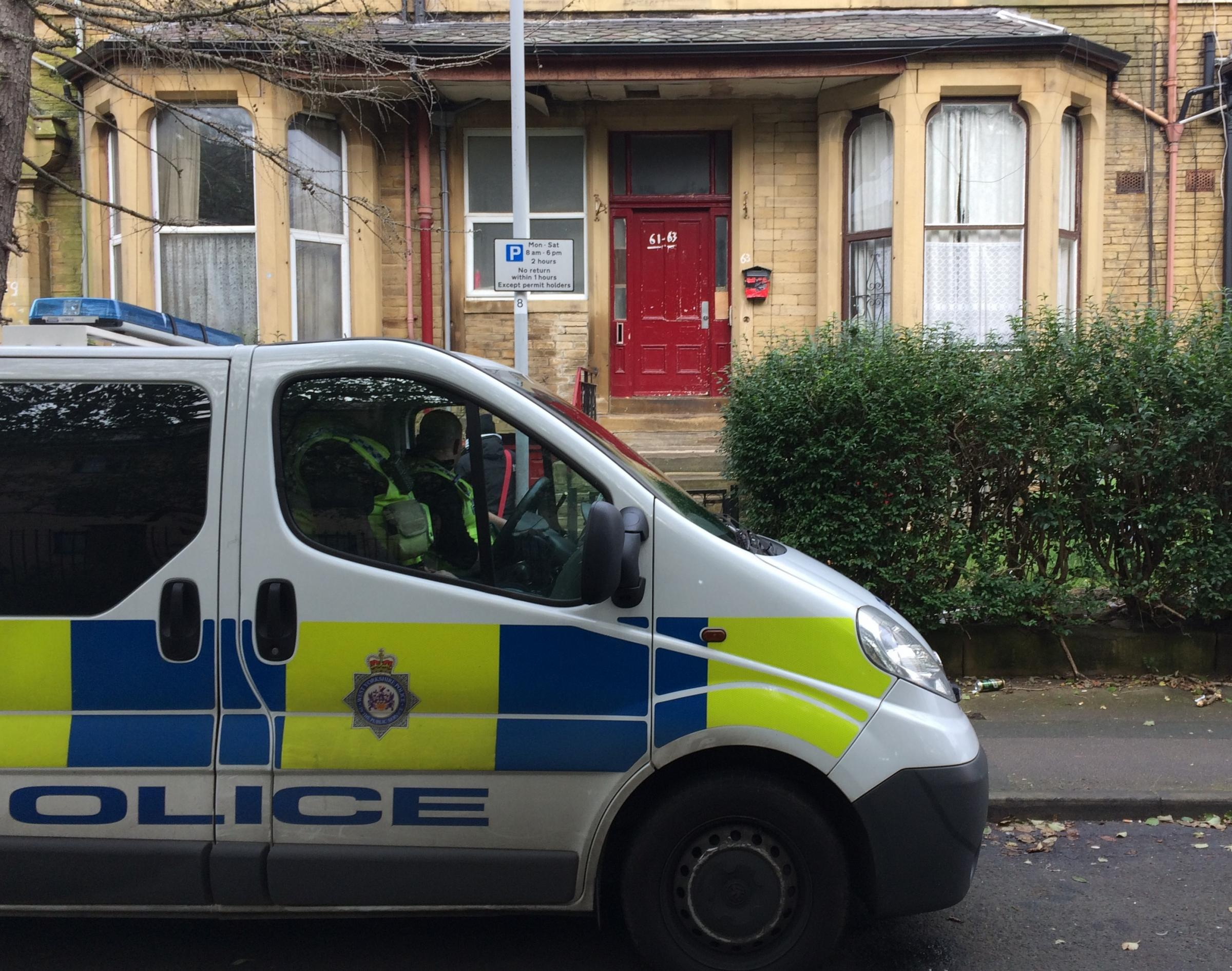 Police officers at the scene of a murder in Ashgrove, Bradford