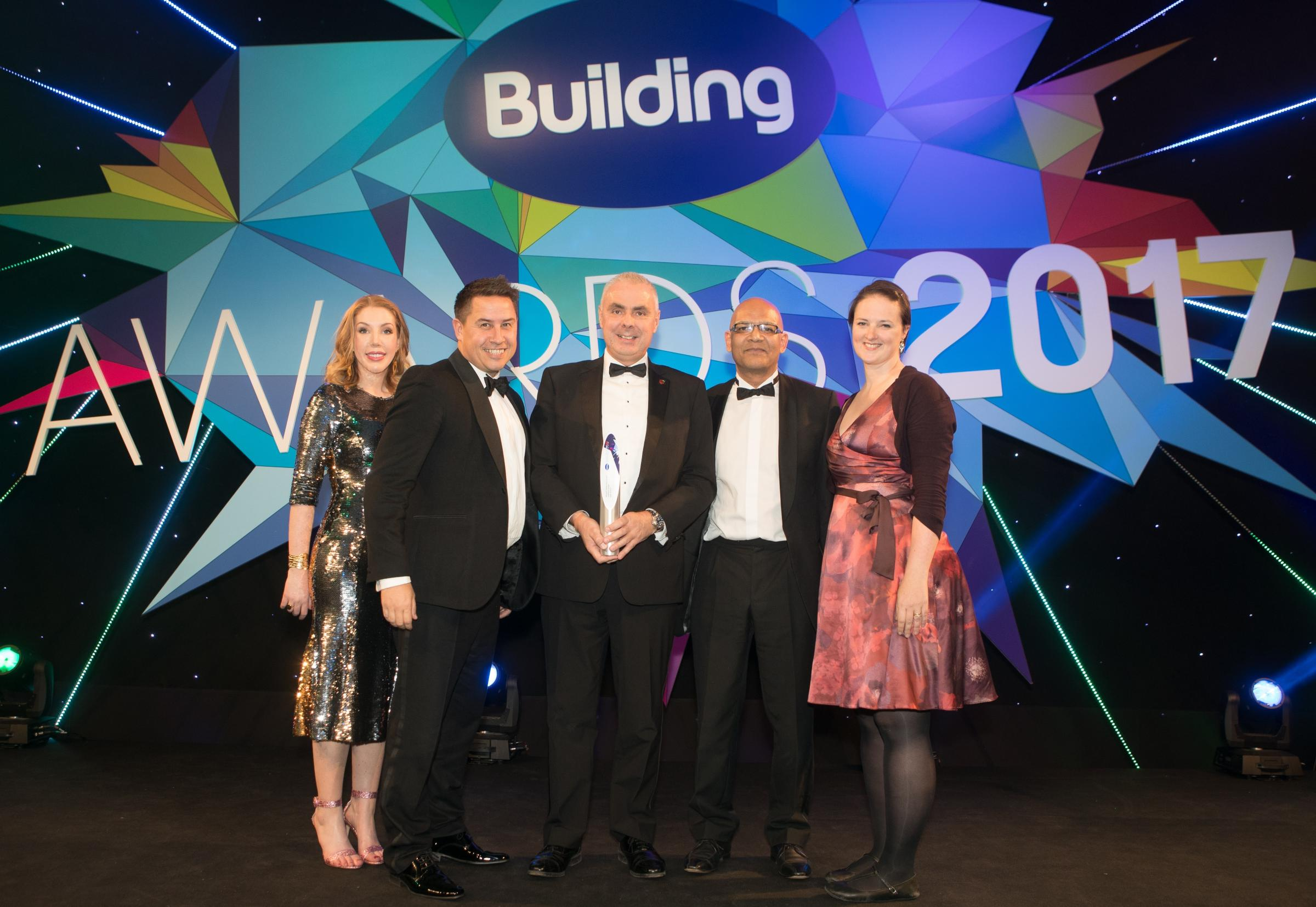 Lee Taylor, NG Bailey's regional director of London and Rail, centre, and Steve Campbell, technical director, to his right, collect the specialist contractor award