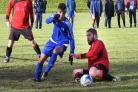 Toller's Tawheed Ahmed leaves Heaton Athletic's Karlis Turlins grounded during their 5-5 GOALS Bradford Sunday Alliance League Championship Division clash Picture: Richard Leach