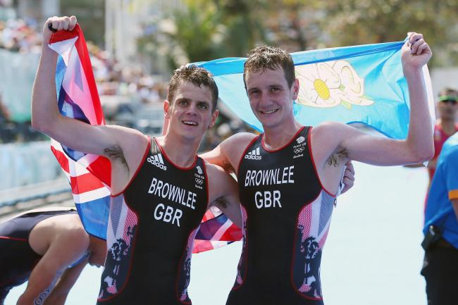 Alistair Brownlee, pictured right celebrating his gold-medal triumph with silver-winning brother Jonny at the Rio Olympics last year, is likely to defend his title in Tokyo  Picture: Alex Livesey/Getty Images