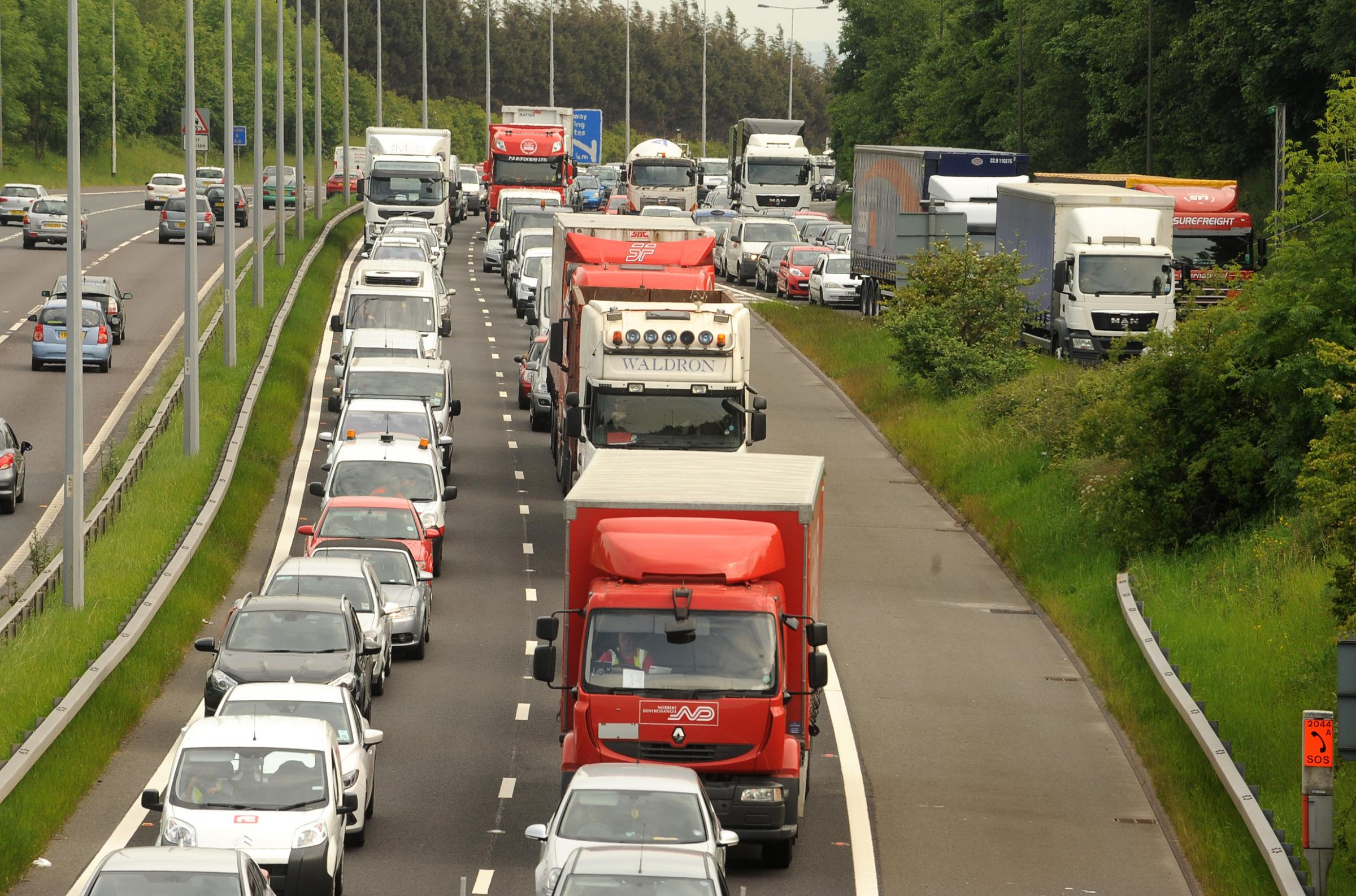A broken down lorry is causing traffic delays around the M606