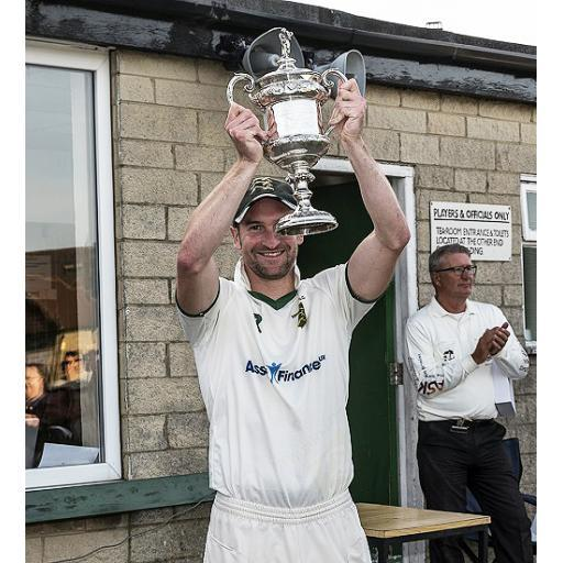 New Farnley skipper Lee Goddard lifts the Priestley Cup after the 2017 final – Picture: Ray Spencer