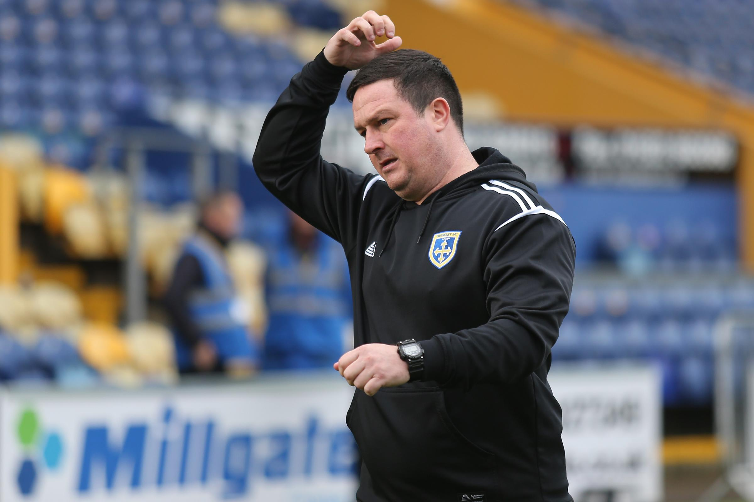 Guiseley boss Paul Cox has plenty to think about