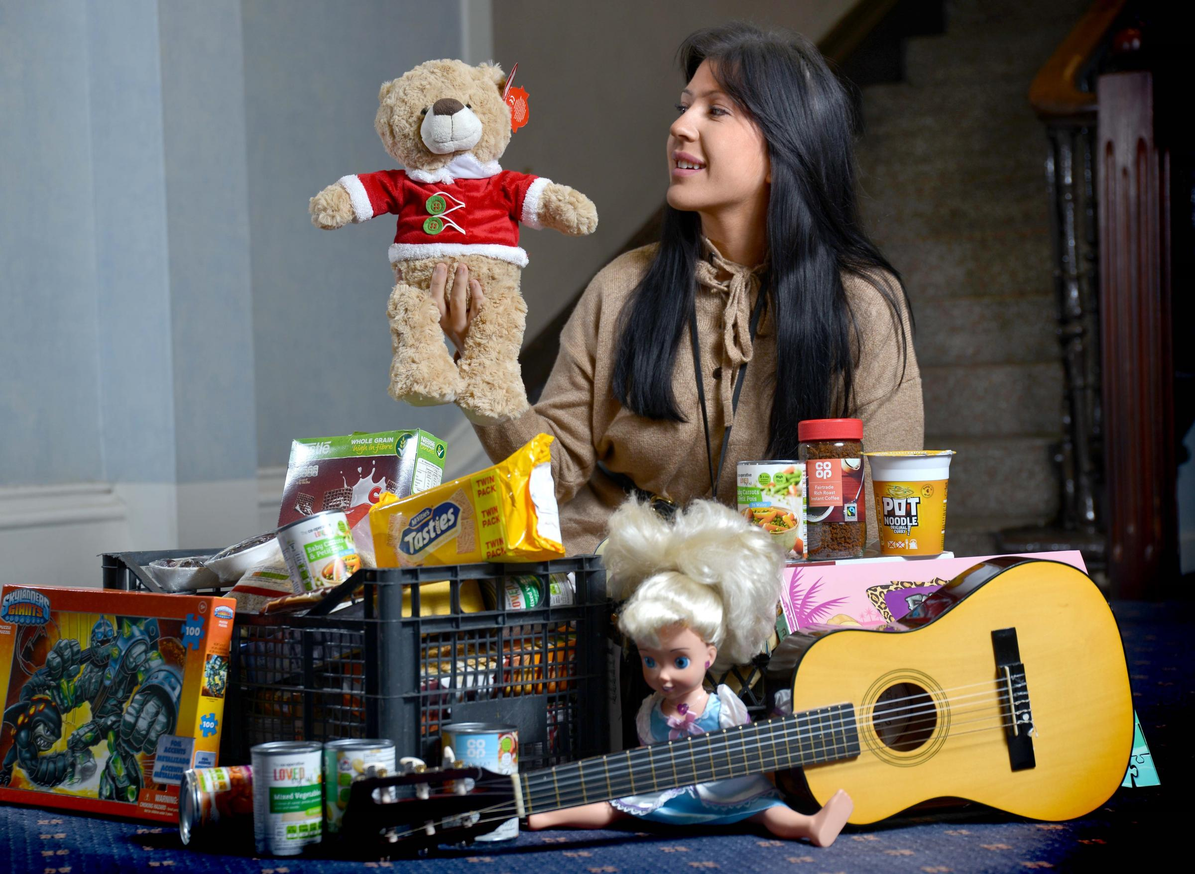 Lauren Wood from the T&A promotions team with some of the items donated to the Toys & Tins Appeal
