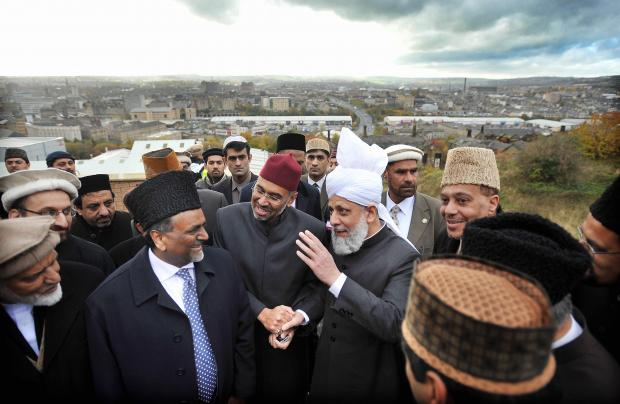 Bradford Telegraph and Argus: The Ahmadiyya leader Hadhrat Mirza Masroor Ahmad, wearing white turban, is shown around the building