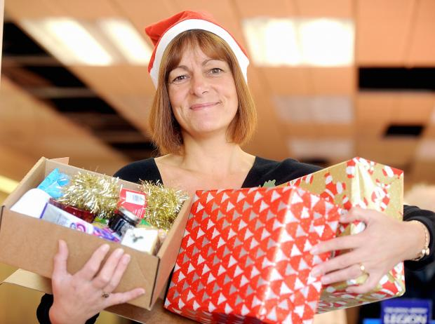 Karen Webster prepares to wrap a parcel