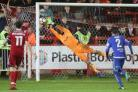 Johnny Maxted makes a fingertip save to keep Accrington Stanley out in the dying minutes of extra time in the FA Cup first round replay.