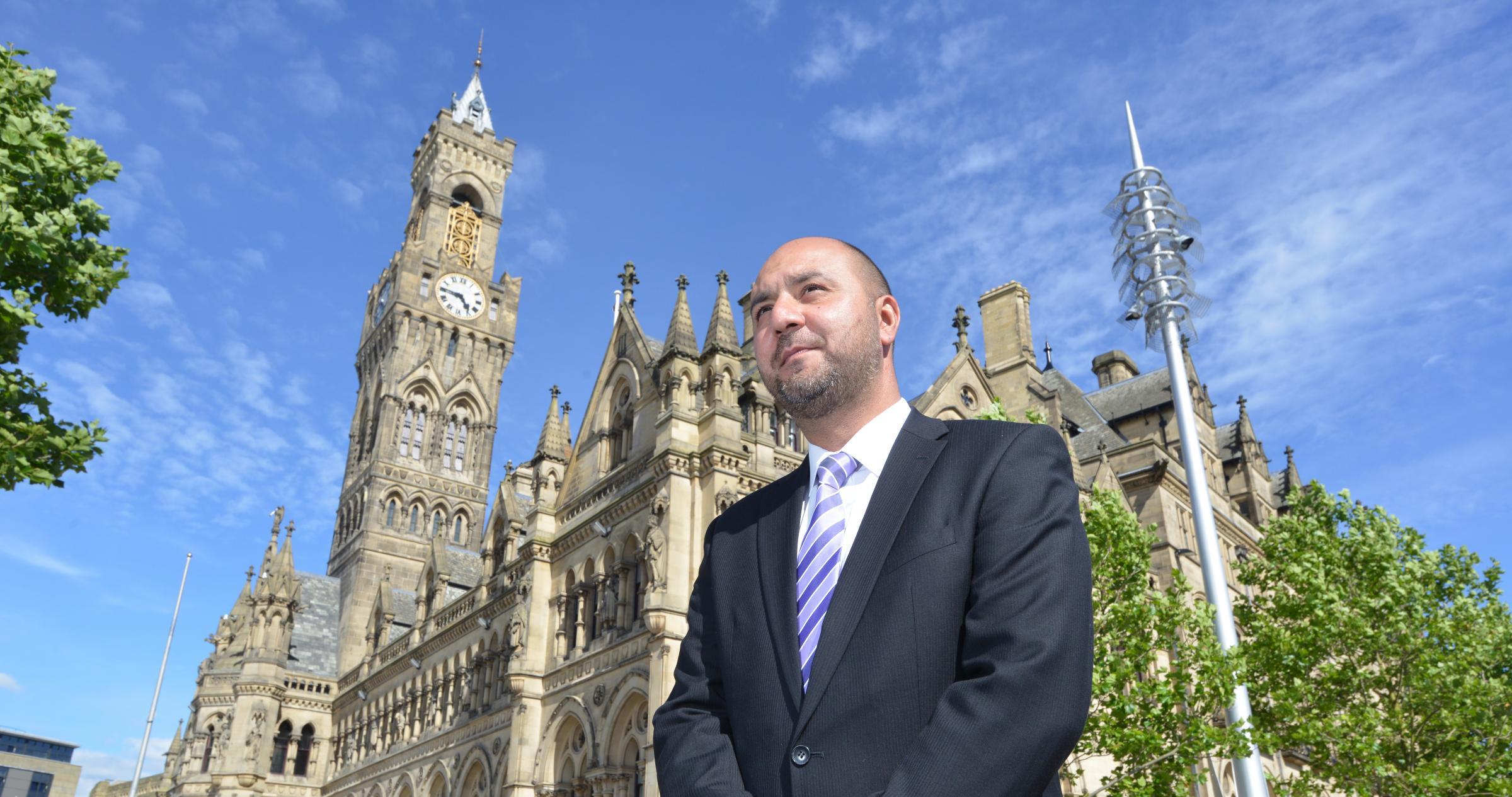 Cllr Imran Khan with backdrop of City Hall..
