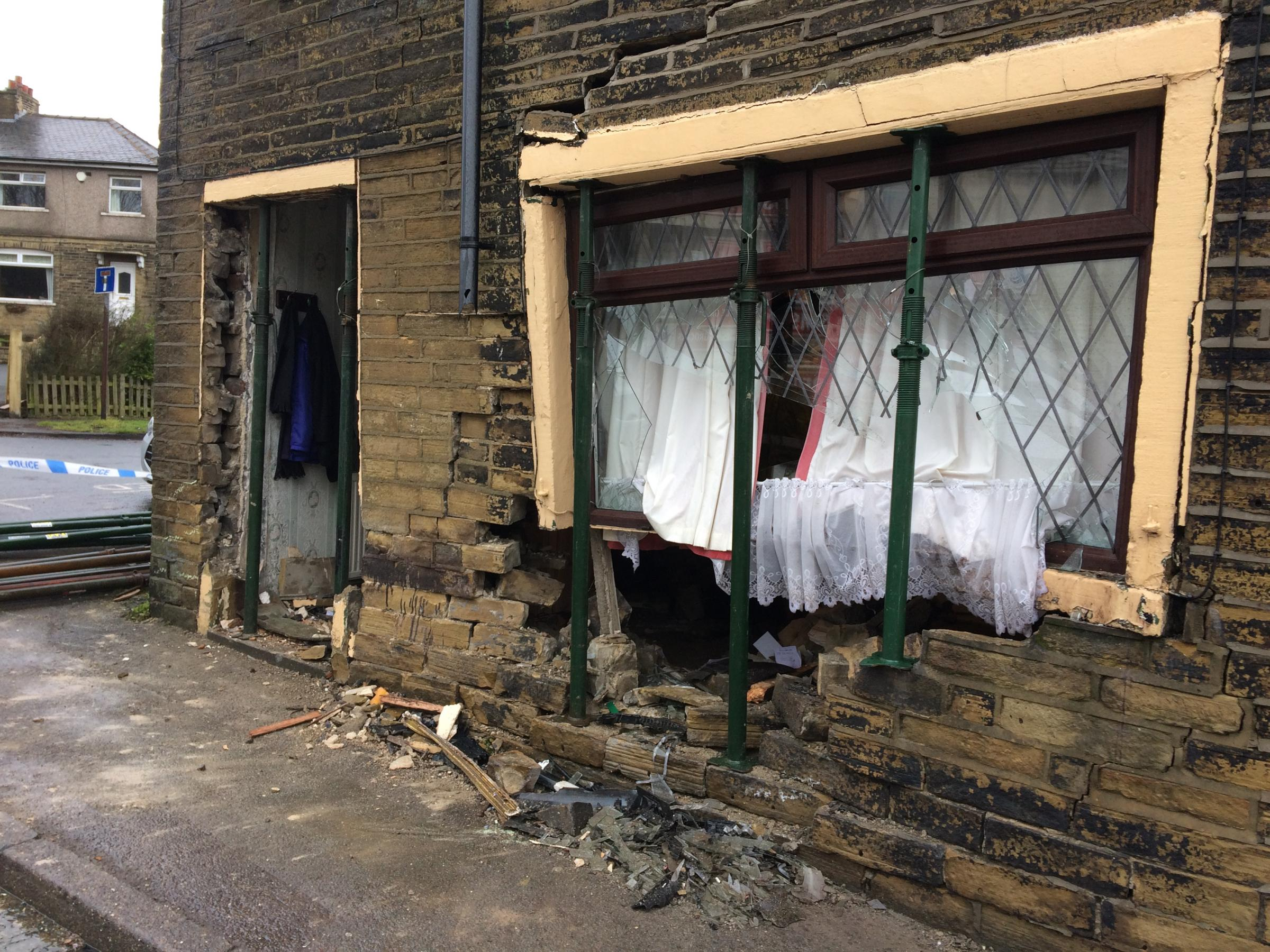 A man died when his car crashed into this house in Queensbury.