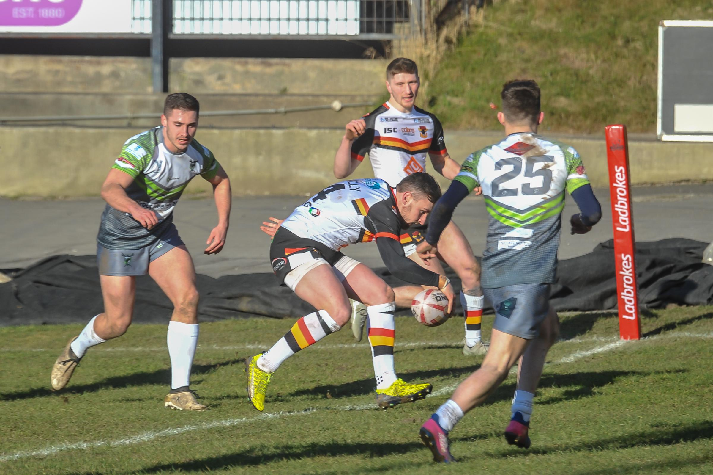 Gregg McNally scores for the Bulls in their 82-6 victory over West Wales Raiders in the third round of the Challenge Cup – Picture: Tom Pearson
