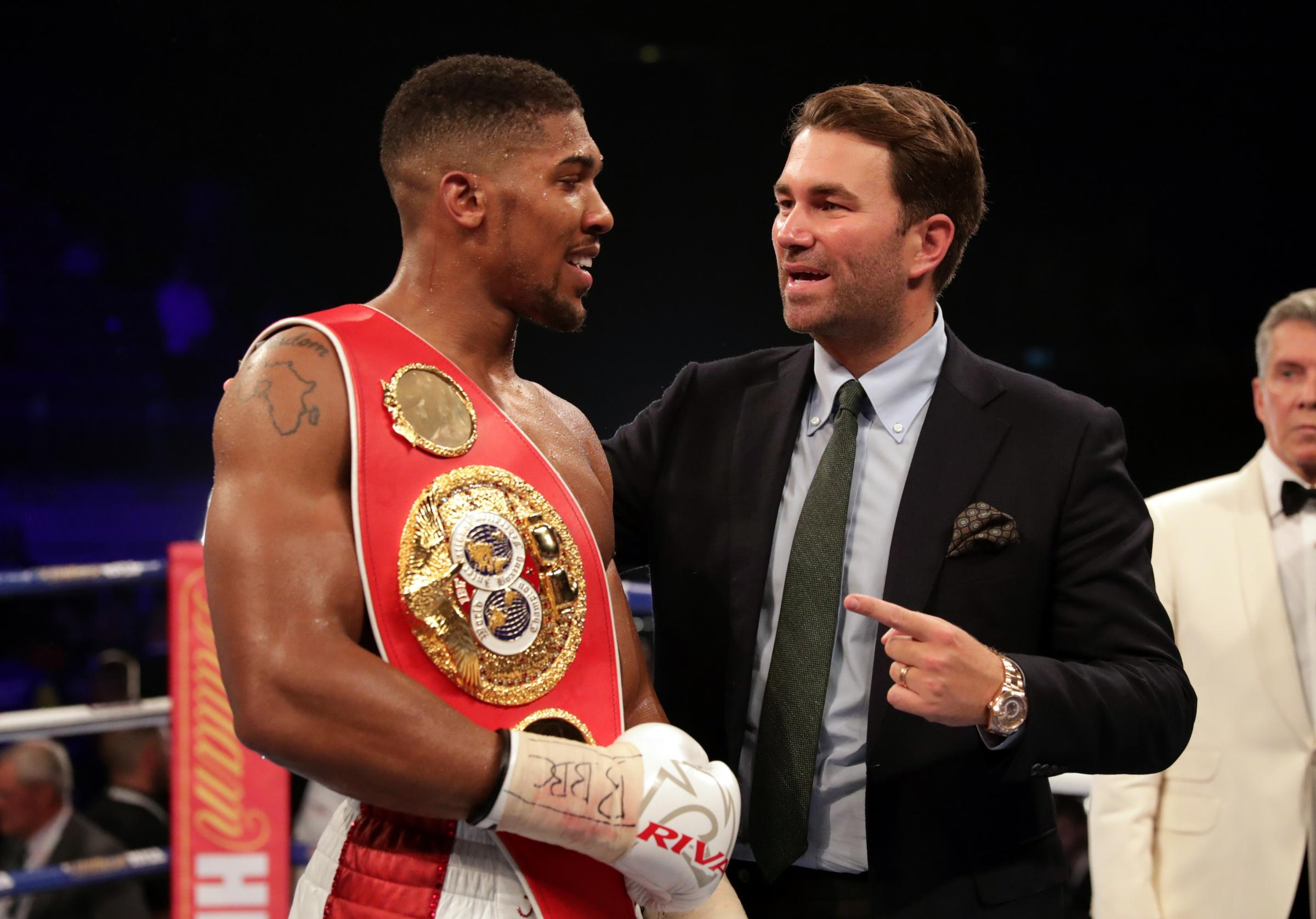FIGHTING TALK: Boxing promoter Eddie Hearn, pictured with world heavyweight champion Anthony Joshua, says he can transform rugby league