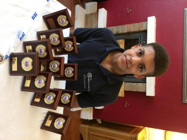 Cameron Green shows off his collection of medals