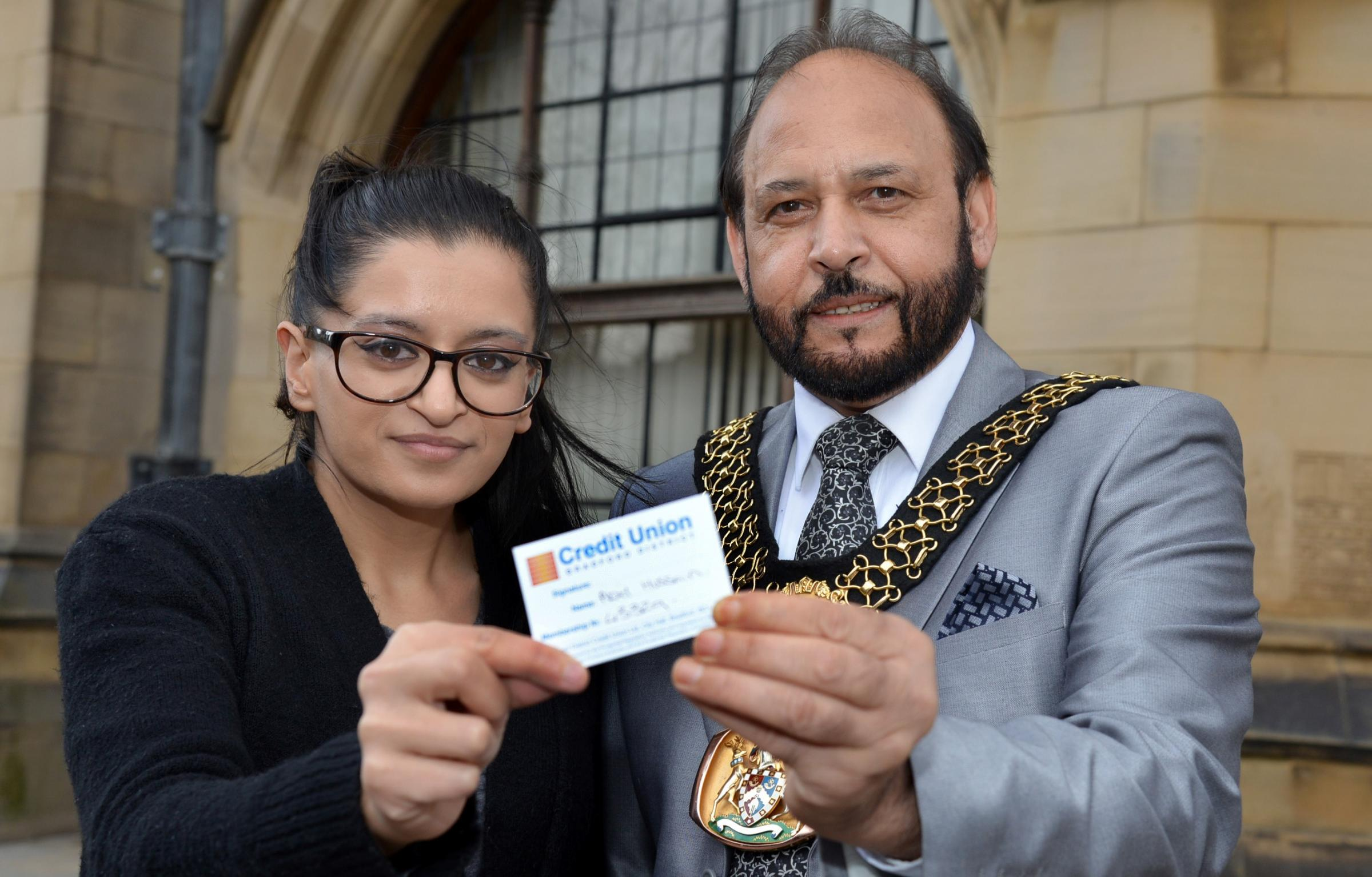 IN CREDIT: The Lord Mayor of Bradford Cllr Abid Hussain receives his savings account card from admin officer Sofia Riaz