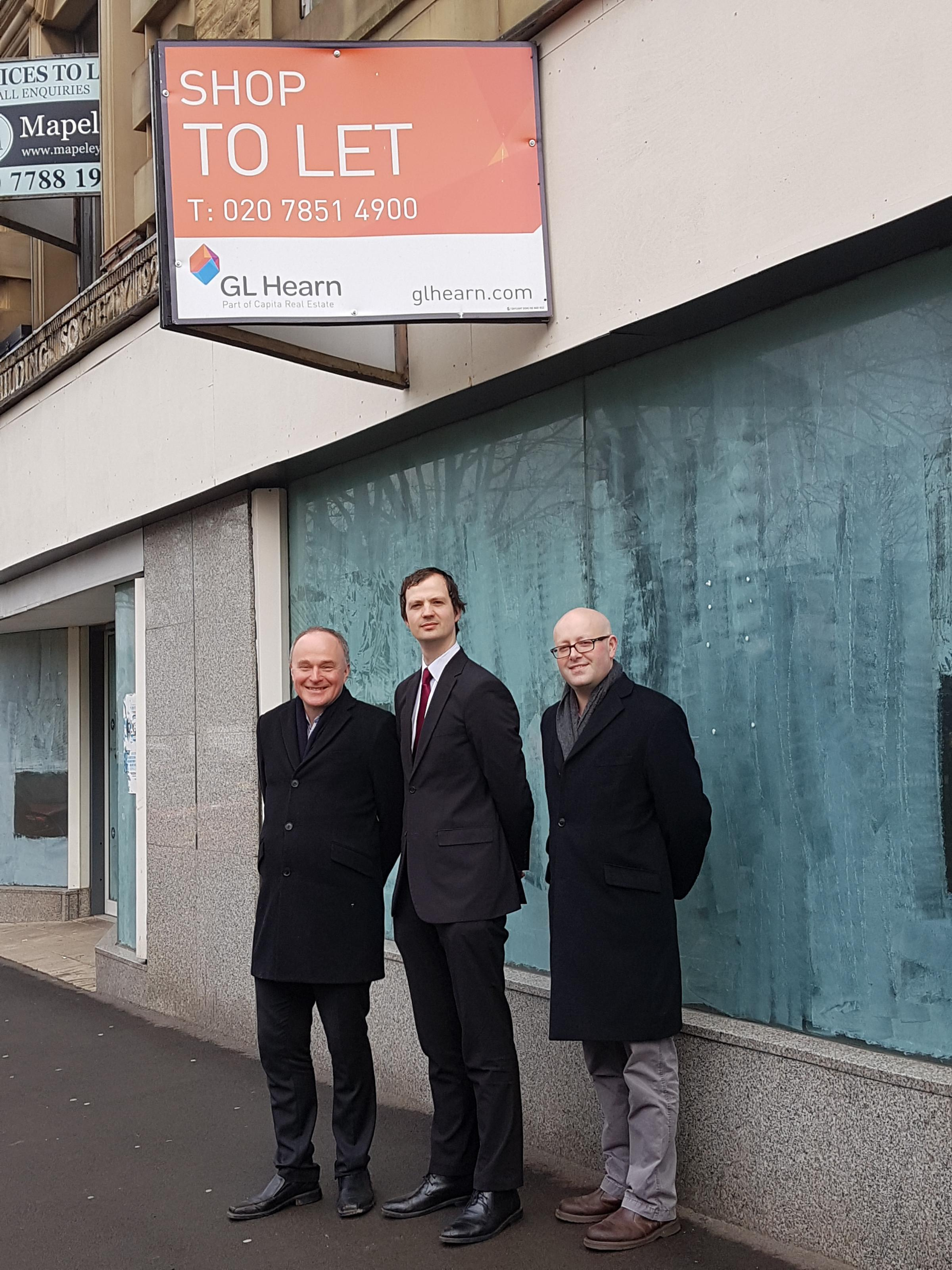 From left, MP John Grogan and councillors Alex Ross-Shaw and Adrian Farley outside a currently-empty Keighley business premises