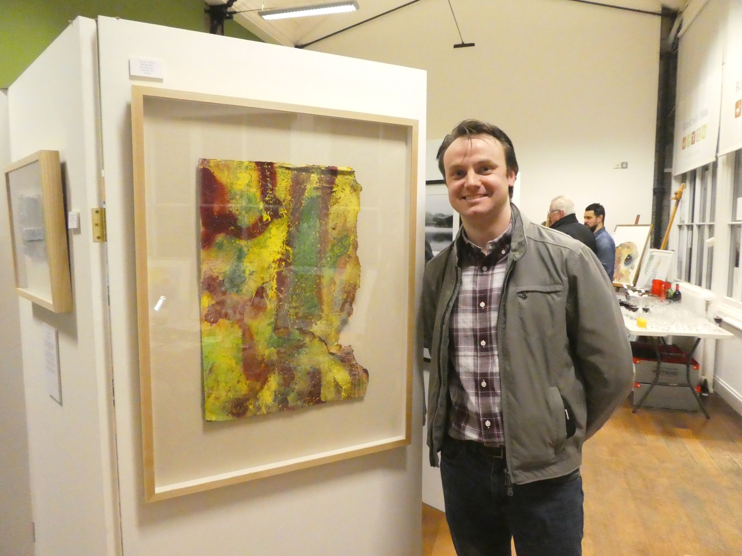 Ben Snowden with his work at the Roundhay Park exhibition