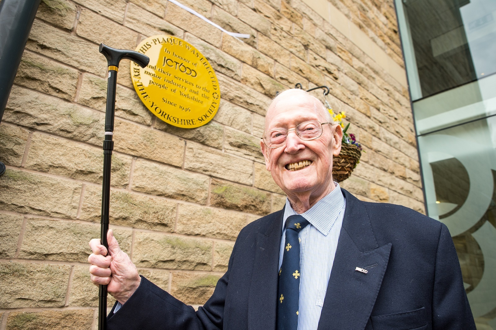 Jack Tordoff with the Yorkshire Society's new plaque at JCT600 headquarters.