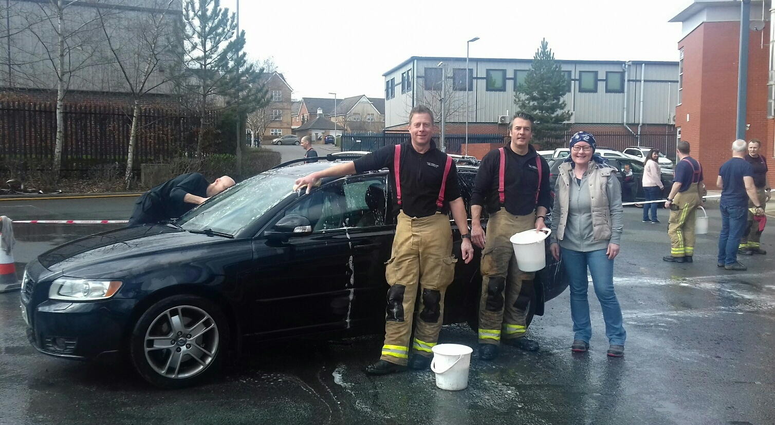 Wendy Wolstenholme with firefighters at Stanningley fire station's car wash