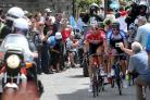 Tour de France riders make their way up Haworth's Main Street in 2014