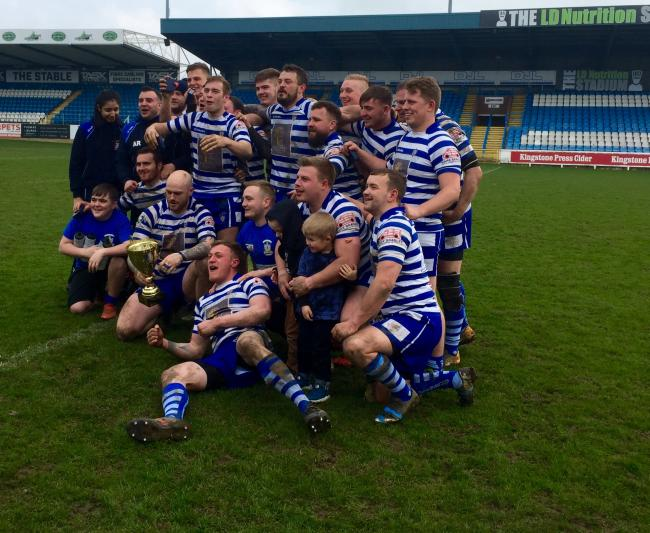 Queensbury celebrate their narrow cup final win