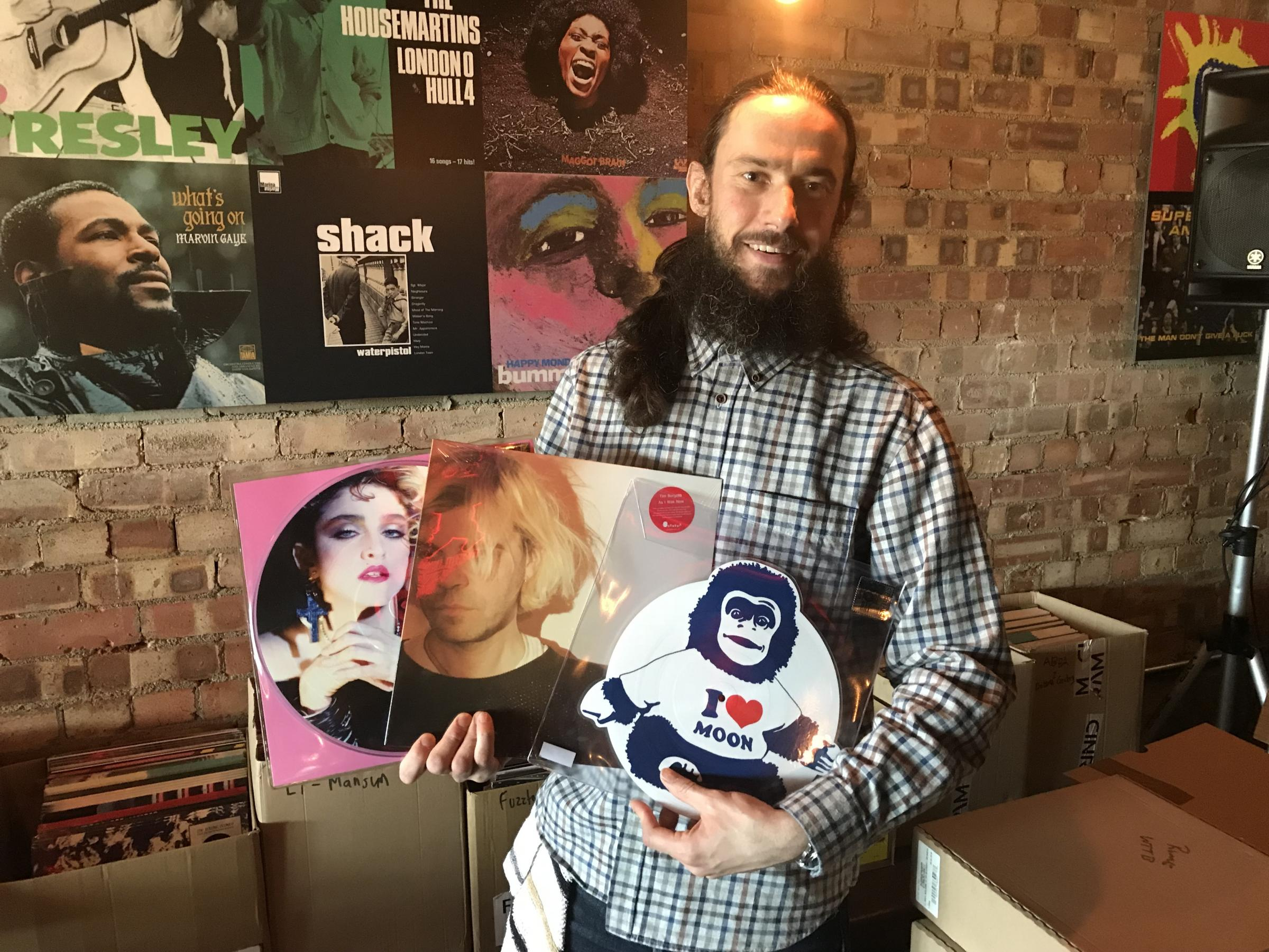 Keith Wildman with a collection of rare records at The Record Café on Record Store Day