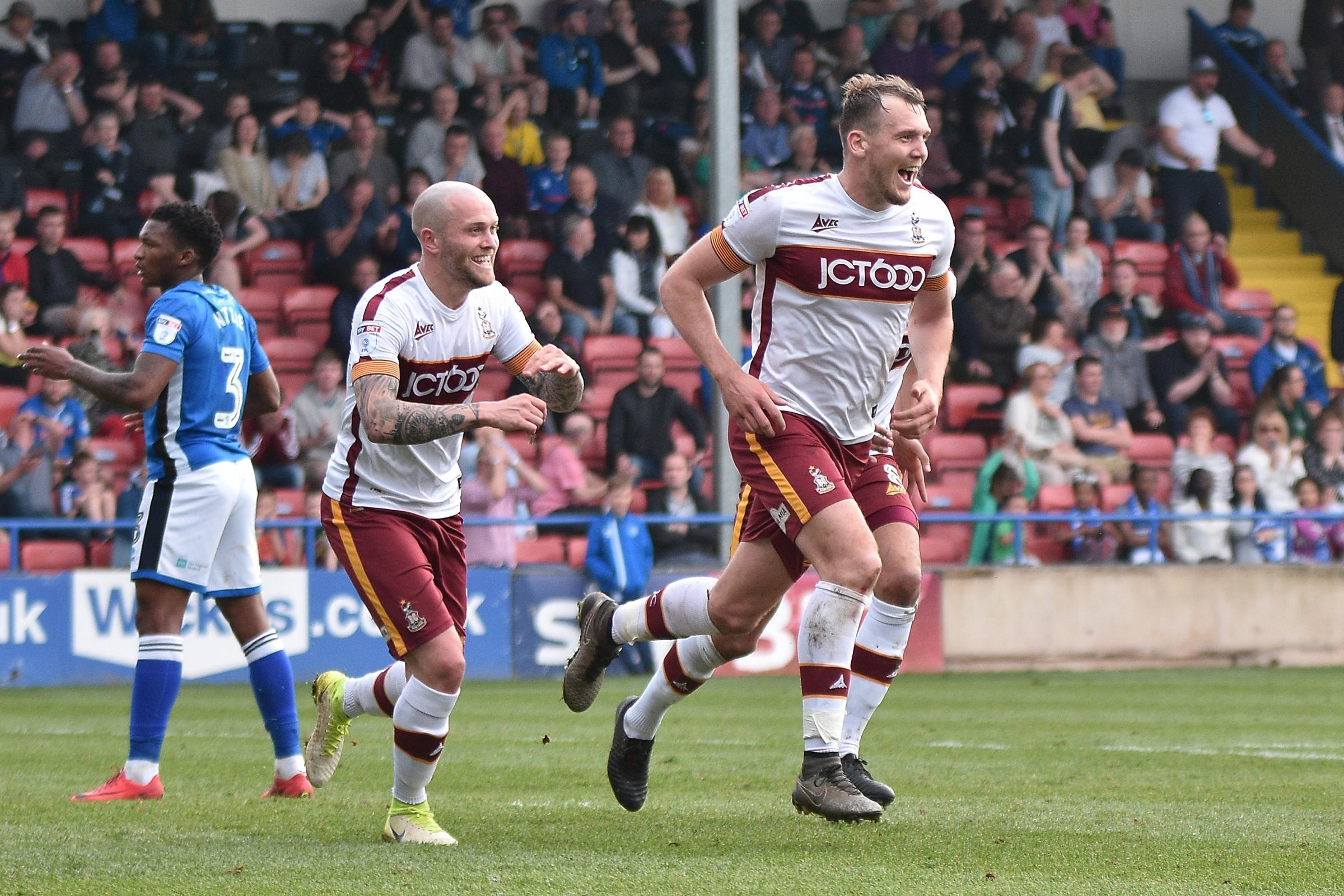 Charlie Wyke wheels away in celebration after scoring City's late equaliser at Rochdale  Picture: Mark Pollitt