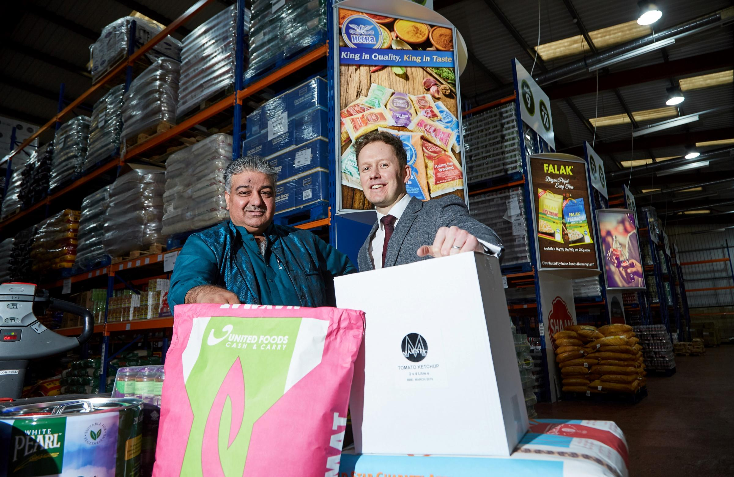 United Foods managing director Saleem Akhtar, left, at the new Cash and Carry store